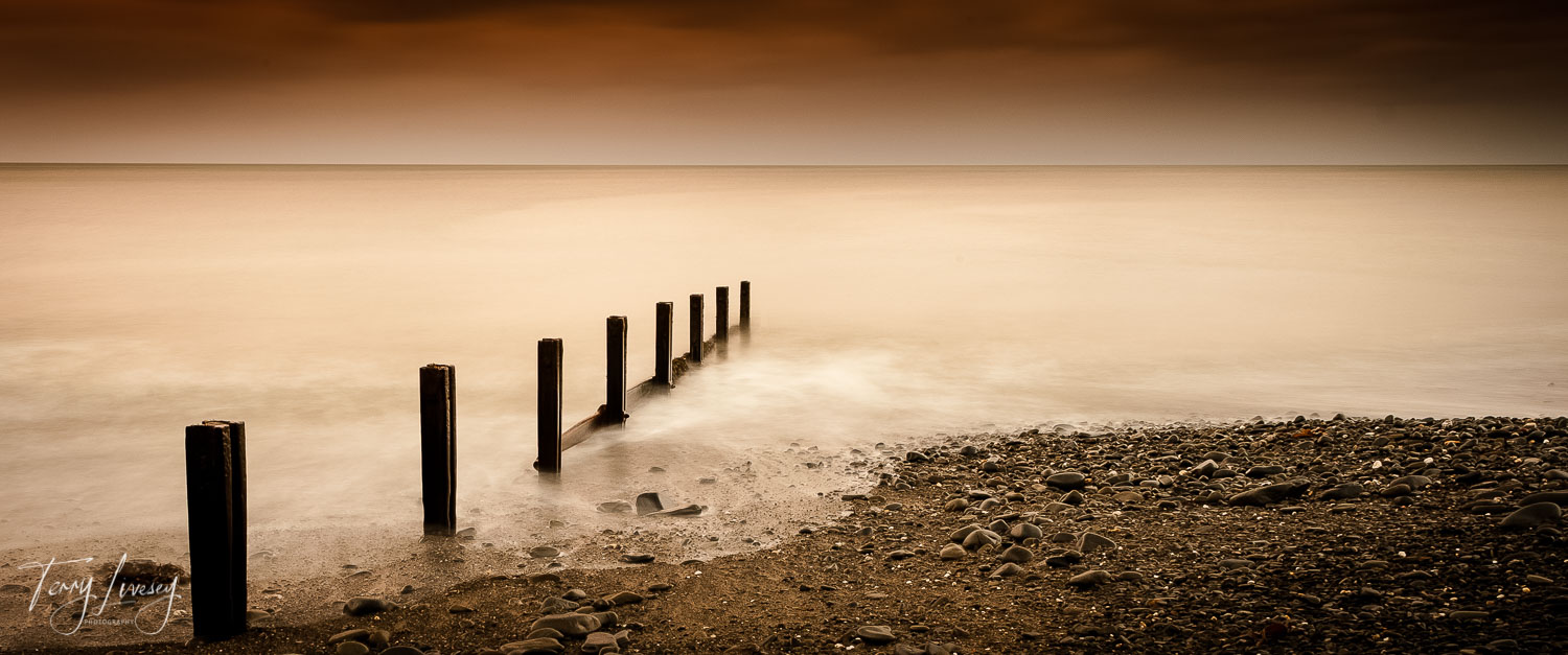 This was taken just before sunrise in Aberarth - Wales on a very cold and wet morning.  But I think it was worth it.